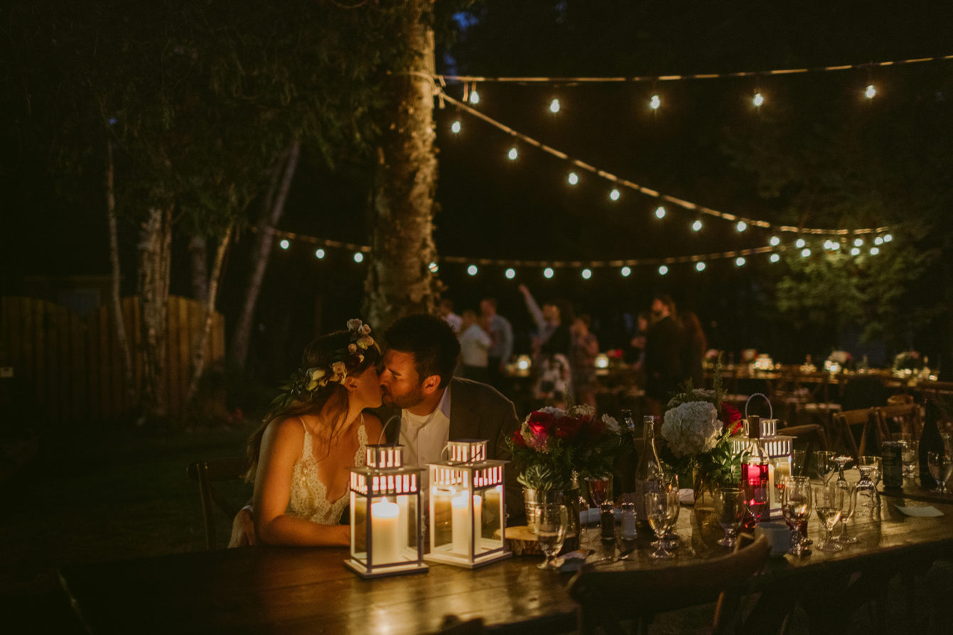 backyard candle light kissing wedding