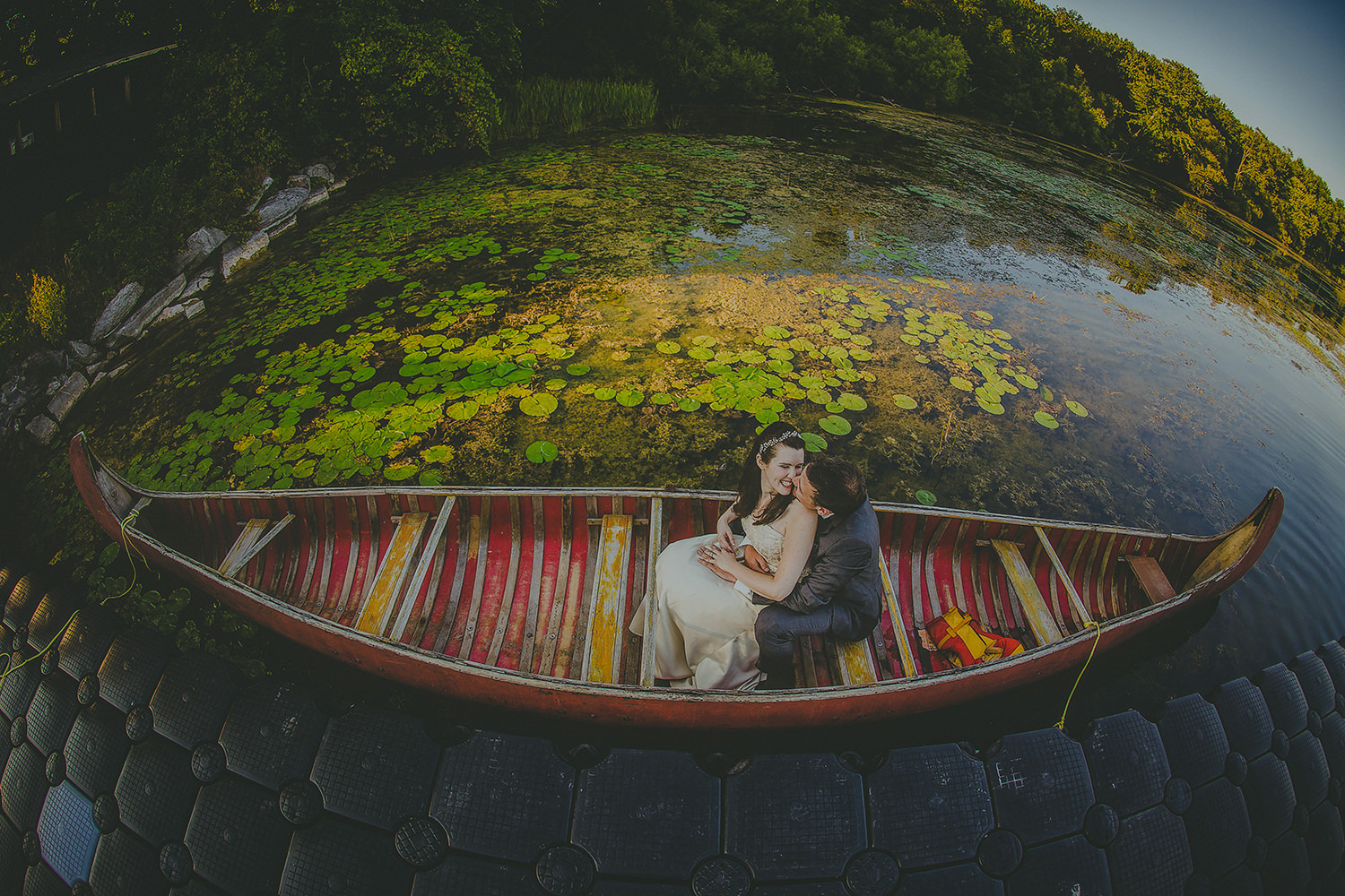 brid-groom-canoe-ride-best-wedding-photographer-in-muskoka-7