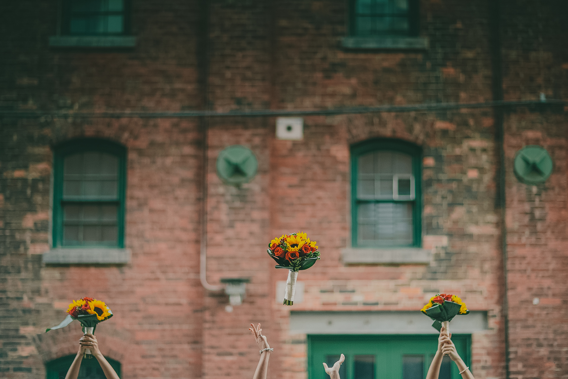 bride and bridesmaids flower bouquet toss at distillery district toronto