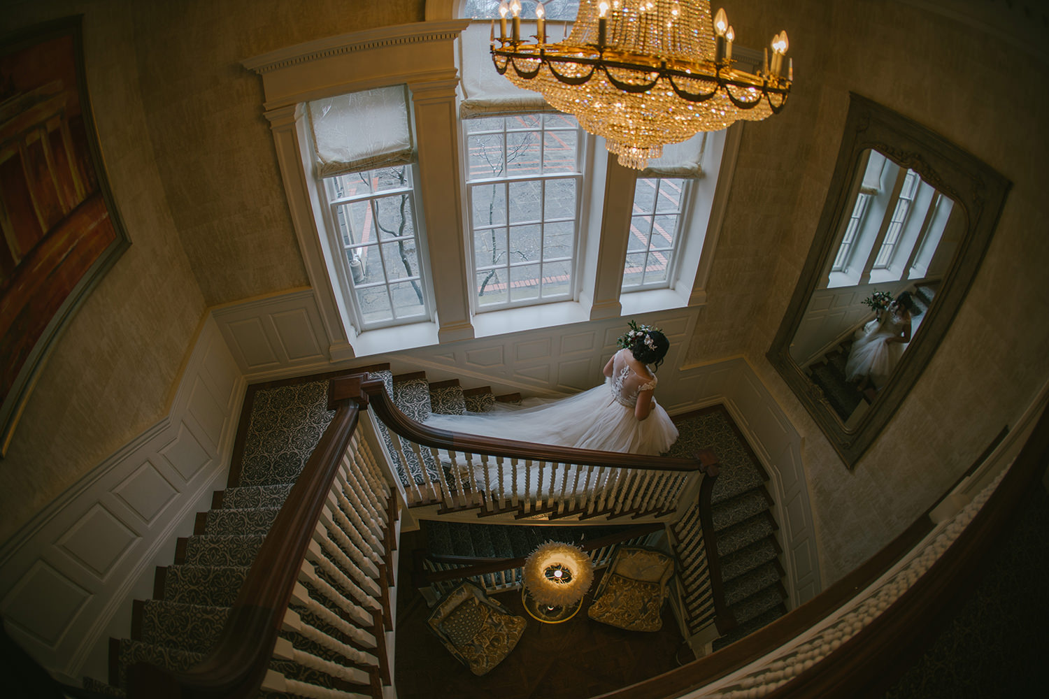 bride-walking-down-stairs-mirror-best-toronto-wedding-photographer-1