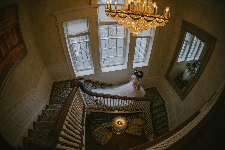 bride-walking-down-stairs-mirror-best-toronto-wedding-photographer-1