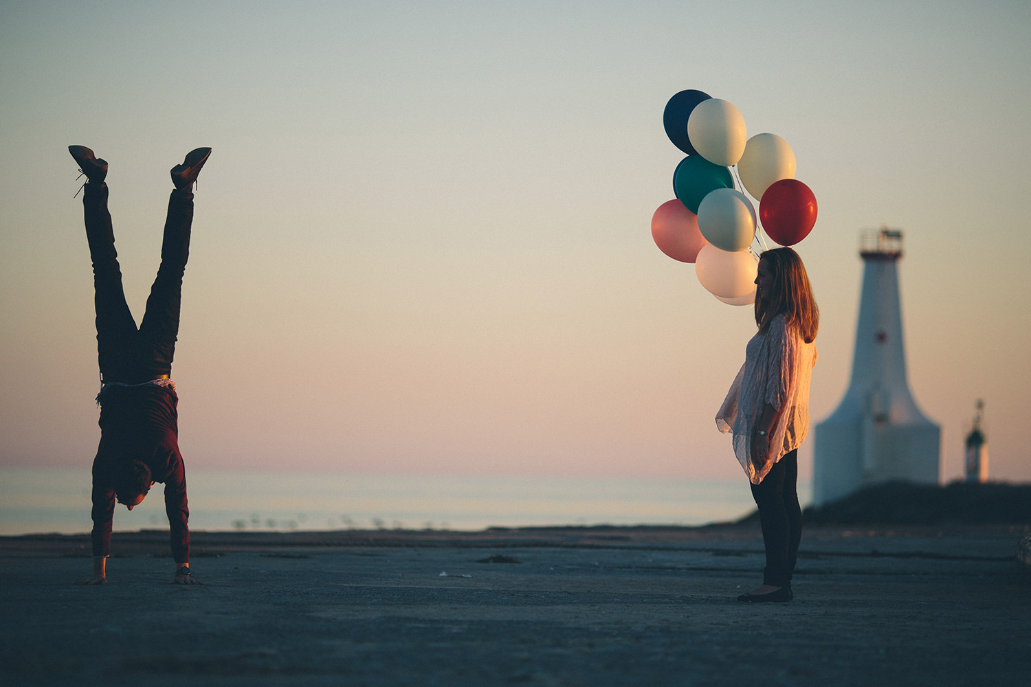 handstand-groom-bride-balloons-sunset-engagement-photographer-4